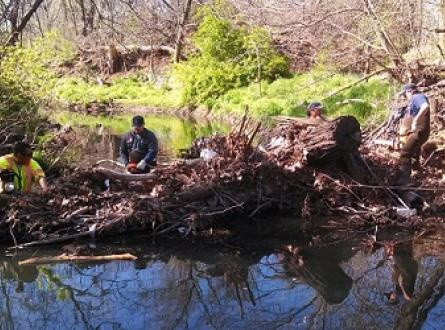 Crews remove debris from a channel