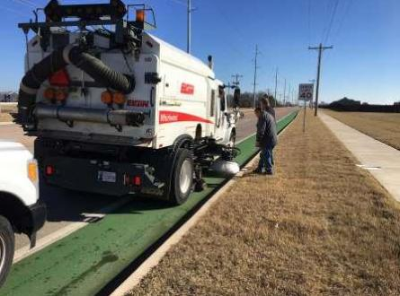 Street sweeper next to bike lane