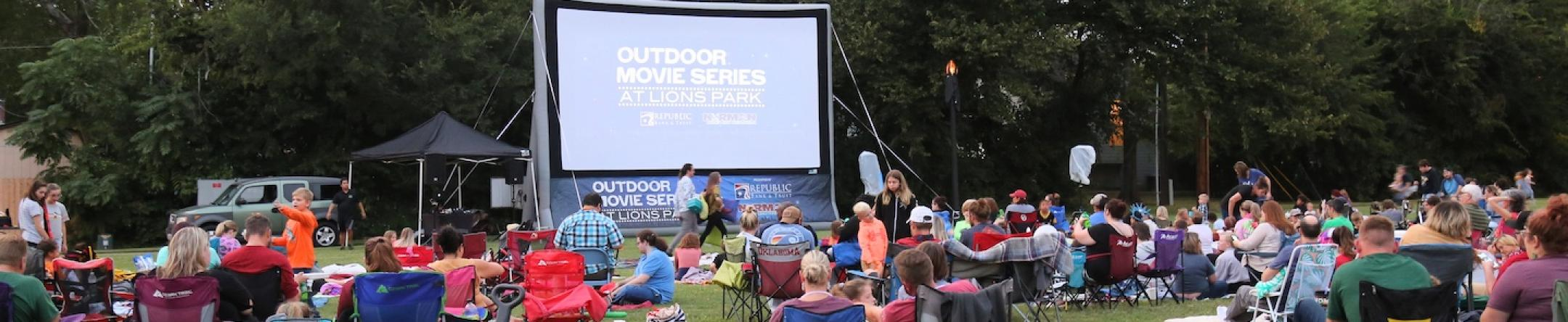 Group Gathering for a Movie in a Park