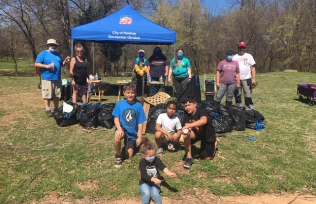 Group picture of volunteers and their trash removed from Woodcreek Park on March 28, 2021